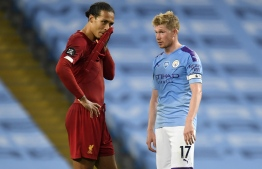 Liverpool's Dutch defender Virgil van Dijk (L) and Manchester City's Belgian midfielder Kevin De Bruyne (R) chat on the pitch after the English Premier League football match between Manchester City and Liverpool at the Etihad Stadium in Manchester, north west England, on July 2, 2020. - Manchester City won the game 4-0. (Photo by PETER POWELL / POOL / AFP) / RESTRICTED TO EDITORIAL USE. No use with unauthorized audio, video, data, fixture lists, club/league logos or 'live' services. Online in-match use limited to 120 images. An additional 40 images may be used in extra time. No video emulation. Social media in-match use limited to 120 images. An additional 40 images may be used in extra time. No use in betting publications, games or single club/league/player publications. /