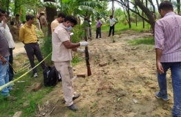 Investigators look at weapons and blood stains at the Kanpur encounter site. PHOTO/PTI