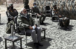 In this handout photograph taken on July 3, 2020 and released by the Indian Press Information Bureau (PIB), India's Prime Minister Narendra Modi (L) sits during a briefing with military commanders as he arrives in Leh, the joint capital of the union territory of Ladakh. - Prime Minister Narendra Modi made a surprise visit to India's northern frontier region with China on July 3 in his first trip to the area since a deadly border clash last month. (Photo by Handout / PIB / AFP) /