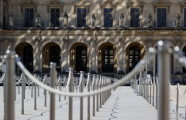 """A picture taken on June 23, 2020 shows the entrance to the Louvre Museum in Paris. - The Louvre museum will reopen its doors on July 6, 2020, after months of closure due to lockdown measures linked to the COVID-19 pandemic, caused by the novel coronavirus. The coronavirus crisis has already caused """"more than 40 million euros in losses"""" at the Louvre, announced its president and director Jean-Luc Martinez, who advocates a revival through """"cultural democratization"""" and is preparing a """"transformation plan"""" for the upcoming Olympic Games in 2024. (Photo by THOMAS SAMSON / AFP)"""
