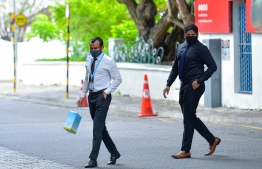 Civil servants in the capital city of Male' during the new normal. AHMED AWSHAN ILYAS/ MIHAARU