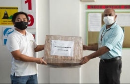 Representative from Replan private limited hands over equipment. PHOTO: REPLAN