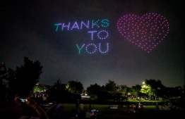"This handout photo taken on July 4, 2020 and released on July 6 by South Korea's Ministry of Land, Infrastructure, and Transport shows a drone display showing messages of support for the country amid the covid-19 pandemic, above a park in central Seoul. (Photo by Handout / South Korea's Ministry of Land, Infrastructure, and Transport / AFP) / -----EDITORS NOTE --- RESTRICTED TO EDITORIAL USE - MANDATORY CREDIT ""AFP PHOTO / Ministry of Land, Infrastructure, and Transport"" - NO MARKETING - NO ADVERTISING CAMPAIGNS - DISTRIBUTED AS A SERVICE TO CLIENTS"