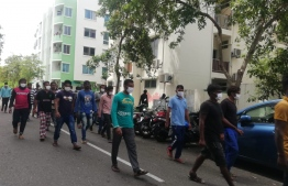 Expatriates employed by Island Expert Pvt Ltd protesting on the streets of Hulhumale' over delays in salary payments. PHOTO: SOCIAL MEDIA