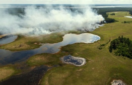 A view of a forest fire in central Yakutia from a helicopter of the Yakut Branch of the Aerial Forest Protection Service. PHOTO: CNN