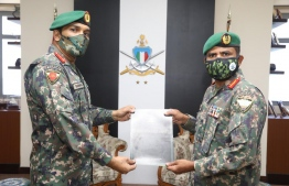 Chief of Defence Force Major General Abdulla Shamal confers the title of Adjutant General on Colonel Mohamed Ibrahim by in a special ceremony held at MNDF's headquarters. PHOTO: MNDF