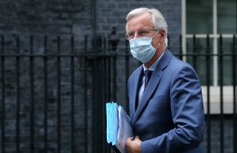 EU chief Brexit negotiator Michel Barnier arrives wearing a face mask as a precaution against the spread of COVID-19 at 10 Downing Street in central London on July 8, 2020, ahead of his meeting with Britain's Prime Minister Boris Johnson. - London and Brussels said Monday the latest round of trade talks would start later than scheduled this week as both sides try to thrash out a new post-Brexit relationship. PHOTO: ISABEL INFANTES / AFP