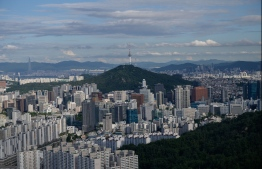 A general view shows the Seoul city skyline from a hilltop viewpoint on July 10, 2020.  PHOTO: ED JONES / AFP