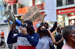 Protesters at a demonstration held near Minister of Gender, Family and Social Services demanding justice for victims and survivors of rape and sexual assault. PHOTO: MIHAARU