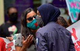 Founder member of 'Nufoshey' and gender equality advocate Sara Naseem negotiating with a police officer during the #JaagaEhNei protest held with a list of demands for the administration to ensure justice for rape, sexual assault and harassment. PHOTO: MIHAARU