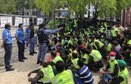 Expatriate workers of Island Expert rounded up following a protest staged over unpaid wages on July 13. PHOTO: MIHAARU