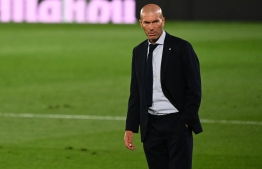 Real Madrid's French coach Zinedine Zidane reacts during the Spanish League football match between Real Madrid and Alaves at the Alfredo Di Stefano stadium in Valdebebas near Madrid on July 10, 2020. (Photo by GABRIEL BOUYS / AFP)