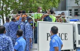 Police arrest 41 expatriate workers of Island Expert from the protest held in Hulhumale' on July 13, 2020. PHOTO: NISHAN ALI / MIHAARU