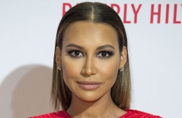 """(FILES) In this file photo taken on April 16, 2016 Actress Naya Rivera  attends the 23rd Annual Race To Erase MS Gala in Beverly Hills California. - Rescuers on July 13, 2020 found a body at the California lake where """"Glee"""" star Naya Rivera went missing last week. The Ventura County Sheriff's office said """"recovery is in progress"""" of the unidentified body, after a sixth day of searching for the US actress began again at first light.Rivera, 33, is believed to have accidentally drowned in Lake Piru after renting a boat at the camping and recreational hotspot with her four-year-old son, authorities said last week. (Photo by VALERIE MACON / AFP)"""
