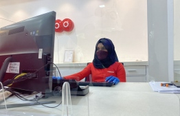An employee of Ooredoo Maldives working during the 'new normal' period. PHOTO: OOREDOO