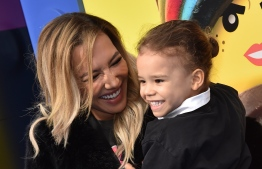 """US actress Naya Rivera and son Josey Hollis Dorsey arrive for the premiere of """"The Lego Movie 2: The Second Part"""" at the Regency Village theatre on February 2, 2019 in Westwood, California. PHOTO: CHRIS DELMAS / AFP"""