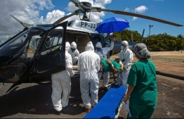 A 77-year-old COVID-19 positive patient is transferred by helicopter from the municipality of Monte Alegre to the municipality of Santarem in the Brazilian state of Para, on July 15, 2020 to receive treatment amid the novel coronavirus pandemic. (Photo by TARSO SARRAF / AFP)