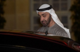 (FILES) In this file photo taken on November 21, 2018 Abu Dhabi Crown Prince Sheikh Mohammed bin Zayed Al Nahyan leaves after a working dinner with the French prime minister at the Hotel de Matignon in Paris. - French authorities are opening an investigation into accusations of complicity in acts of torture against the powerful crown prince of Abu Dhabi, Mohammed bin Zayed Al-Nahyan, sources said today. (Photo by LUCAS BARIOULET / AFP)