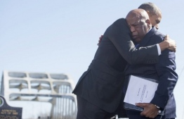 (FILES) In this file photo taken on March 07, 2015 US President Barack Obama (R) hugs US Representative John Lewis, Democrat of Georgia, one of the original marchers at Selma, during an event marking the 50th Anniversary of the Selma to Montgomery civil rights marches at the Edmund Pettus Bridge in Selma, Alabama. - John Lewis, the non-violent civil rights warrior who marched with Martin Luther King Jr and nearly died from police beatings before serving for decades as a US congressman, has died at age 80, House colleagues said July 17, 2020. In December 2019, he was diagnosed with pancreatic cancer. (Photo by SAUL LOEB / AFP)