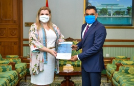 Vice President Faisal Naseem accepting the Dhivehi translation of The Nelson Mandela rules, which outline the standard minimum rules for the treatment of prisoners. PHOTO: HOME MINISTRY