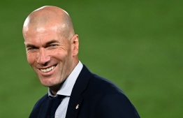 Real Madrid's French coach Zinedine Zidane celebrates winning the Liga title  after the Spanish League football match between Real Madrid CF and Villarreal CF at the Alfredo di Stefano stadium in Valdebebas, on the outskirts of Madrid, on July 16, 2020. (Photo by GABRIEL BOUYS / AFP)
