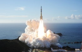 """In this handout photograph taken and released on July 20, 2020 by Mitsubishi Heavy Industries an H-2A rocket carrying the Hope Probe known as """"Al-Amal"""" in Arabic, developed by the Mohammed Bin Rashid Space Centre (MBRSC) in the United Arab Emirates (UAE) to explore Mars, blasts off from Tanegashima Space Centre in southwestern Japan. - The first Arab space mission to Mars blasted off on July 20 aboard a rocket from Japan, with the probe dubbed """"Hope"""" successfully separating about an hour after liftoff. (Photo by Handout / Mitsubishi Heavy Industries / AFP) /"""