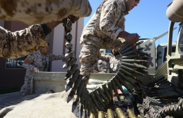 (FILES) In this file photo taken on April 08, 2019, fighters from a Misrata armed group loyal to the internationally recognised Libyan Government of National Accord (GNA) prepare their ammunition before heading to the frontline as battles against Forces of Libyan strongman Khalifa Haftar, in Tripoli - The US charged on July 16, 2020, that the EU's Operation Irini to enforce a UN embargo on sending weapons to war-torn Libya lacked seriousness, sharing Turkey's criticism that the effort is biased. (Photo by Mahmud TURKIA / AFP)