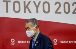 President of the Tokyo 2020 Organising Committee Yoshiro Mori wearing a face mask arrives at a news conference after giving a presentation to the International Olympic Committee (IOC) about the rearrangement of the Tokyo Summer Olympic Games for next year, in Tokyo on July 17, 2020. - Tokyo 2020 organisers said on July 17 they have secured all the venues needed to hold the Olympics next summer, clearing a major hurdle to hosting the event postponed over the coronavirus. (Photo by ISSEI KATO / POOL / AFP)