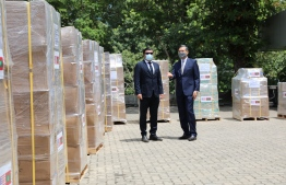 US Deputy Chief of Mission (DCM) to Sri Lanka and Maldives Martian Kelly and Maldivian High Commissioner to Sri Lanka Omar Razak standing near the aid packages of PPE donated by US to Maldives. PHOTO: SRI LANKAN HIGH COMMISSION.