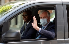 EU chief Brexit negotiator Michel Barnier wears a face mask as a precaution against the spread of the novel coronavirus, as he leaves from Europe House, headquarters of the EU Delegation to the UK, in London on July 23, 2020. - Barnier held a press conference at the EU delegation headquarters on the Brexit negotiations. (Photo by JUSTIN TALLIS / AFP)