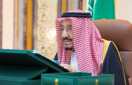 A handout picture provided by the Saudi Press Agency (SPA) authorities on July 22, 2020, shows King Salman bin Abdulaziz chairing a virtual cabinet meeting from his office at the King Faisal Specialist Hospital in Riyadh. - Ailing Saudi King Salman chaired a virtual cabinet meeting from a hospital office late Tuesday, a day after he was admitted due to gall bladder inflammation, the Saudi Press Agency reported. The report was accompanied by footage from the spacious office in the hospital where the king presided over the meeting from behind a large desk. (Photo by - / SPA / AFP) /