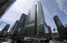 (FILES) In this file photo the headquarters of Goldman Sachs is pictured on April 17, 2019 in New York City. - A blowout performance in trading and underwriting lifted Goldman Sachs' revenues in the second quarter as it reported flat earnings compared with the year-ago period. Profits came in at $2.2 billion, translating into $6.26 per share, much better than the $3.78 expected by analysts.  Revenues surged 41 percent to $13.3 billion.Goldman's markets division benefited from volatility amid the upheaval caused by the coronavirus shutdowns and aggressive stimulus measures by central banks. (Photo by Johannes EISELE / AFP)