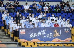 Medical staff, police officers and people, who are invited to watch the match due to their contribution of defeating the COVID-19 coronavirus, are seen before the Chinese Super League (CSL) football match between Guangzhou Evergrande and Shanghai Shenhua in Dalian in China's northeastern Liaoning province on July 25, 2020. (Photo by STR / AFP) /