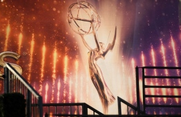 "(FILES) In this file photo an Emmy Awards statue is pictured ahead of the 71st Emmy Awards on September 21, 2019, in Los Angeles, California. - HBO's ""Watchmen,"" an innovative reimagining of a superhero graphic novel that tackled racism in America, topped the nominations for this year's Emmy Awards on July 28, 2020 with 26. Perennial Amazon hit ""The Marvelous Mrs Maisel"" was tops among the comedies with 20 nominations, followed by dark dramas ""Ozark"" and ""Succession"" at 18 each.The Emmy -- honoring the best in television -- will be handed out in Los Angeles on September 20. It will be the first major awards show since the outbreak of the coronavirus pandemic, which has ravaged Hollywood, stalling production of many television shows and shuttering movie theaters. (Photo by Robyn Beck / AFP)"