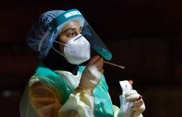 A health worker wearing PPE. PHOTO: MIIHAARU