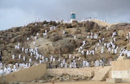 Mulism pilgrims praying on Mount Arafat, also known as Jabal al-Rahma (Mount of Mercy), southeast of the holy city of Mecca, during the climax of the Hajj pilgrimage amid the COVID-19 pandemic on July 30, 2020. Muslim pilgrims converged today on Saudi Arabia's Mount Arafat for the climax of this year's hajj, the smallest in modern times and a sharp contrast to the massive crowds of previous years. PHOTO: STR / AFP