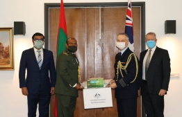 The Australian High Commissioner for Sri Lanka and Maldives David Holly and Australia's Defense Advisor Group Captain Sean Unwin handing over aid supplies worth MVR 1.8 million to the Maldives High Commissioner to Sri Lanka Omar Adul Razzak and Defense Advisor to the High Commission of Maldives Lieutenant Colonel Ismail Naseer.