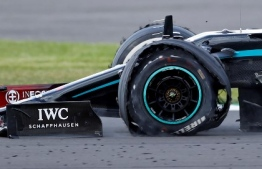 The punctured tyre of Mercedes' British driver Lewis Hamilton punctures is pictured as he goes on to win the Formula One British Grand Prix at the Silverstone motor racing circuit in Silverstone, central England on August 2, 2020. - Lewis Hamilton survived a dramatic finale to win the British Grand Prix on Sunday, just making it across the line on three tyres to beat a fast closing Max Verstappen on Red Bull. The defending world champion claimed his seventh British Grand Prix win as Ferarri's Charles Leclerc came third and Daniel Ricciardo of Renault fourth. (Photo by ANDREW BOYERS / POOL / AFP)