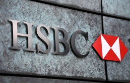 "A HSBC logo is pictured on a wall outside a branch of the bank in central London on August 3, 2020. - HSBC on Monday revealed a 69-percent slump in net profits, joining a number of major bank whose earnings have been slammed by coronavirus fallout. HSBC announced ""reported profit after tax"" of $3.1 billion (2.6 billion euros) compared with almost $10 the first six months of 2019, with spiralling China-US tensions also hurting the Asia-focused lender. (Photo by DANIEL LEAL-OLIVAS / AFP)"