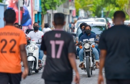 People wear face masks on the streets of Male' City as Maldives enters the 'new normal' amid the COVID-19 pandemic. PHOTO/MIHAARU