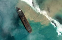"This August 1, 2020, handout satellite image obtained courtesy of Maxar Technologies shows the oil tanker MV Wakashio aground off the Mauritius coast. Mauritius on August 6, 2020, announced that oil was leaking from the Wakashio which ran aground off Pointe d'Esny on July 25, sparking fears among green campaigners of an environmental disaster. ""The ministry has been informed... that there is a breach in the vessel MV Wakashio and there is a leakage of oil,"" the environment ministry said in a statement. The ship was empty at the time but was carrying 200 tonnes of diesel and 3,800 tonnes of bunker fuel, according to the local press. Handout / Satellite image ©2020 Maxar Technologies / AFP"