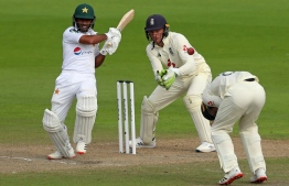 A shot of Pakistan's Cricket Team playing earlier in the year, on August 7, 2020.  Asad Shafiq (L) plays a shot on the third day of the first Test cricket match between England and Pakistan at Old Trafford in Manchester, north-west England. (Photo by LEE SMITH / POOL / AFP) /