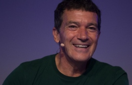 """(FILES) In this file photo taken on September 19, 2019 Spanish actor and director Antonio Banderas smiles during the presentation of the musical """"A Chorus Line"""" in Malaga. - Spanish actor Antonio Banderas announced on his 60th birthday on August 10, 2020 that he was in quarantine after testing positive for the coronavirus but was feeling """"relatively well"""". (Photo by JORGE GUERRERO / AFP)"""