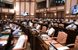 Lawmakers wear face masks and observe physical distancing during a parliament sitting held amid the COVID-19 pandemic. PGOTO/MAJILIS