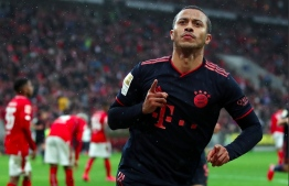 Liverpool signs Bayern Munich's midfielder Thiago Alcantra for a reported fee of USD 26 million.