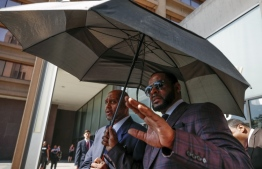 R. Kelly leaves the Leighton Criminal Court Building after a hearing on sexual abuse charges in 2019. PHOTO: KAMIL KRZACZYNSK/AFP