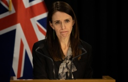 New Zealand's Prime Minister Jacinda Ardern speaks to media regarding the latest case of COVID-19 coronavirus infections, breaking a 102-day run of no local transmissions, at the parliament in Auckland on August 12, 2020. (Photo by Marty MELVILLE / AFP)