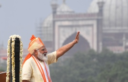 "India's Prime Minister Narendra Modi waves after his speech to the nation during a ceremony to celebrate India's 74th Independence Day, which marks the end of British colonial rule, at the Red Fort in New Delhi on August 15, 2020. - Amnesty International has suspended its Indian operations after its bank accounts were frozen in what it called a government ""witch-hunt"" against rights groups. (Photo by Prakash SINGH / AFP)"
