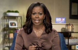 This image grab made on August 17, 2020 from the online broadcast of the Democratic National Convention, being held virtually amid the novel coronavirus pandemic, shows former First Lady Michelle Obama speaking during the opening night of the convention. - America's political convention season begins tonight with former first lady Michelle Obama addressing the Democrats' now-virtual gathering set to anoint Joe Biden, as President Donald Trump defies coronavirus concerns to rally supporters in battleground Wisconsin. (Photo by - / DEMOCRATIC NATIONAL CONVENTION / AFP) /