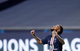 Paris Saint-Germain's Brazilian forward Neymar celebrates the victory at the end of the UEFA Champions League semi-final football match between Leipzig and Paris Saint-Germain at the Luz stadium, in Lisbon on August 18, 2020. (Photo by Manu Fernandez / POOL / AFP)